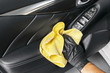 A man cleaning car with microfiber cloth. Car detailing. Valeting concept. Selective focus. Car detailing. Cleaning with sponge. Worker cleaning. Microfiber and cleaning solution to clean