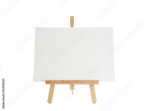 Tablou Canvas Wooden easel with blank sheet of paper on white background