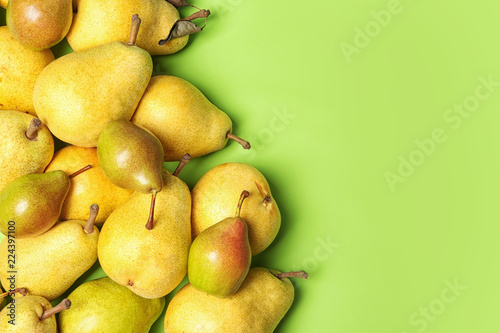 Flat lay composition with fresh ripe pears and space for text on color background