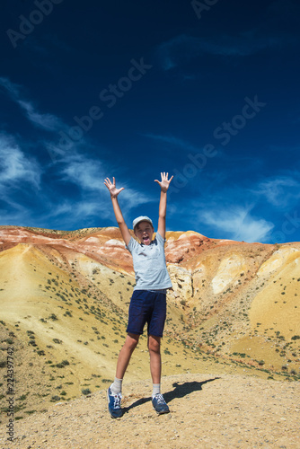 Fotografie, Tablou  Teen boy in valley of Mars landscapes in the Altai Mountains, Kyzyl Chin, Siberi