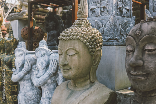 Canvas Print Old asian statues on the Asian market
