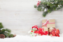 Christmas Gift Boxes, Snowman Toy And Fir Tree