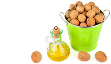 Oil Of Walnut And Nut Fruit Isolated On White Background.