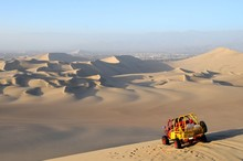 10652136 - View Of Sand Dessert With Dune Buggy In Foreground