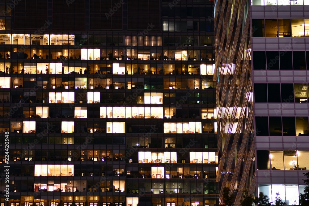 Fototapety, obrazy: Office building at night. Late night at work. Glass curtain wall office building