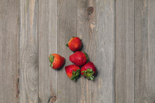 Close Up Of Strawberries On A Wooden Table
