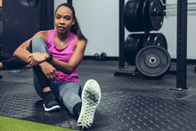 Portrait Of Young Woman Sitting In Gym