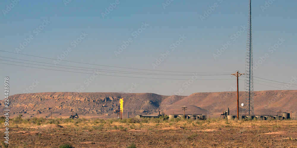 Photo & Art Print Methane flare burning at a flare stack in rural