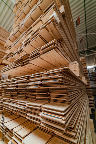 Fototapeta high racks with a parquet board are in the warehouse of plant. Manufacturing of a parquet board. Close-up obraz na płótnie