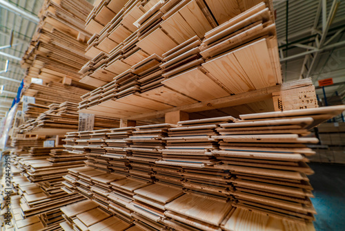 Fototapeta racks with a parquet board are in the warehouse of factory. Manufacturing of a parquet board. obraz na płótnie