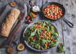 Chickpea and veggies salad with spinach leaves, healthy homemade vegan food, diet. white beans in tomato sauce