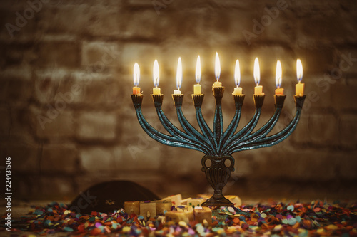 Jewish ritual holiday Hanukkah menorah traditional burning candles