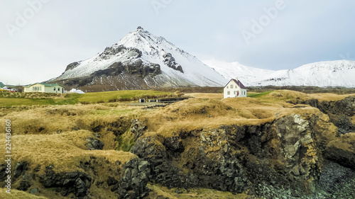 Valokuva  Snæfellsnes Peninsula Fishing Village and mountains with snow at western Iceland