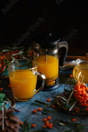 Staande foto Thee Tea of sea-buckthorn berries with branch