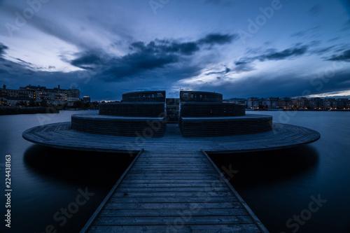 Poster UFO wooden pier in stockholm at dusk