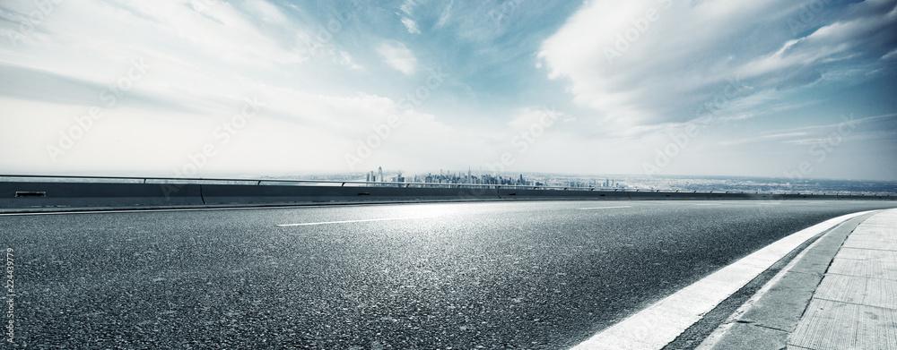 Fototapeta empty highway through modern city