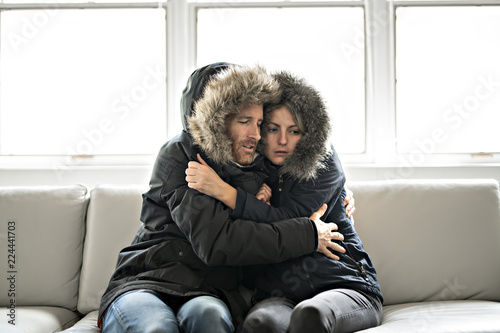 Obraz na płótnie Couple have cold on the sofa at home with winter coat