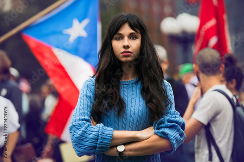 Fotografie, Obraz Beautiful activist woman protesting on city street with arms crossed