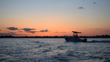 Fishing Boat At Sunset On An O...