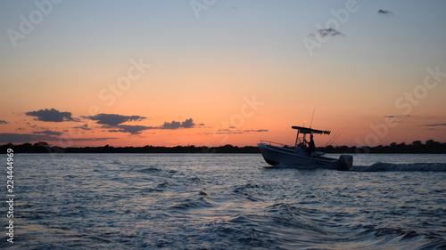 Fotografie, Tablou Fishing Boat at Sunset on an Ocean Bay