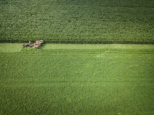 An Amish Farmer And His Four Horse Team Begin To Plow The Corn Fields For End Of Season Corn And Feed Viewed From An Aerial Drone