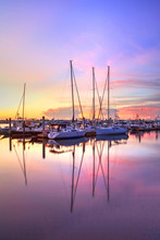 Sunrise Over A Quiet Harbor In Old Naples, Florida