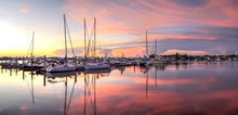 Sunrise Over A Quiet Harbor In...