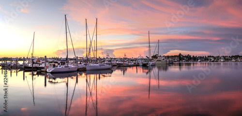 Sunrise over a quiet harbor in old Naples, Florida