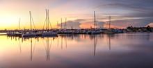 Sunrise Over A Quiet Harbor In...