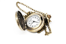An Ancient Pocket Watch On A White Background.