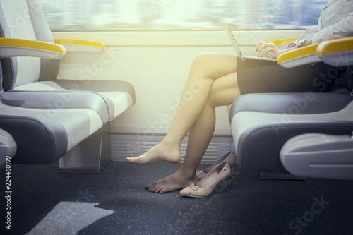 Fotografía Unknown businesswoman barefoot in airport train