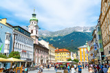 Fototapeta Uliczki - INNSBRUCK, AUSTRIA - AUGUST 29, 2019: Innsbruck town center with lots of people and street cafes in Innsbruck, Tyrol, Austria