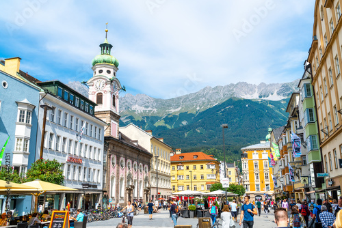 INNSBRUCK, AUSTRIA - AUGUST 29, 2019: Innsbruck town center with lots of people and street cafes in Innsbruck, Tyrol, Austria