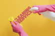 two hands in pink gloves cleaning the solid color surface, clean service text creative idea d