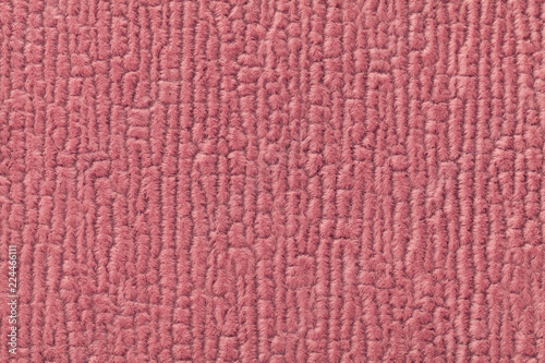 Fotografía  Dark pink fluffy background of soft, fleecy cloth