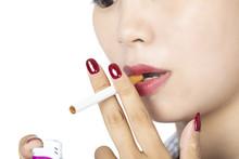 Asian Woman Lighting A Cigaret...