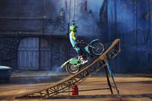 Pro Motocross Rider Riding Fmx Motorbike, Jumping Performing Extreme Stunt. Professional Biker Jumps