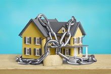 House Model And Chains, Real Estate Concept