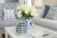 White Flower In Ceramic Vase On Table In Contemporary Living Room