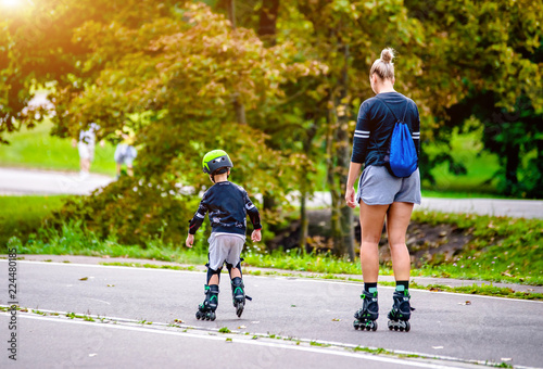 Mom and son roller skating in the Park