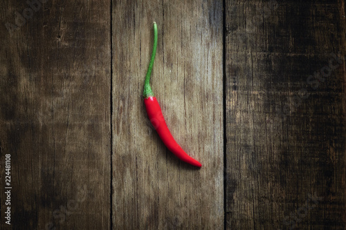 Fotobehang Hot chili peppers red chili peppers on wooden table