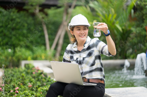 Fotografía  World environment day concept ,Thai Asian Female engineering working with a tabl