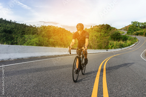 Cycling competition,cyclist athletes riding a race at high speed on road way, Sports men bikes in the morning,vintage color,selective focus, sports concept,low angle view,Business competition