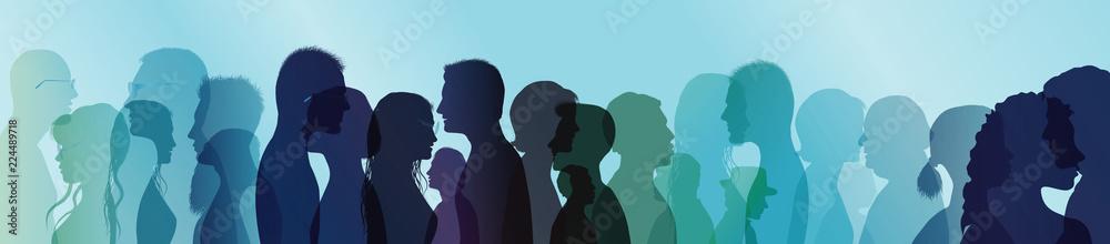Fototapeta Talking crowd. People talking. Dialogue between people. Colored silhouette profiles. Multiple exposure