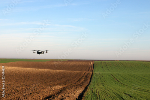 The drone is flying over the plowed field autumn season