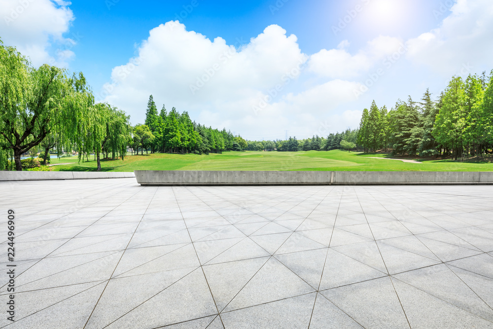 Empty city square floor and green woods scenery