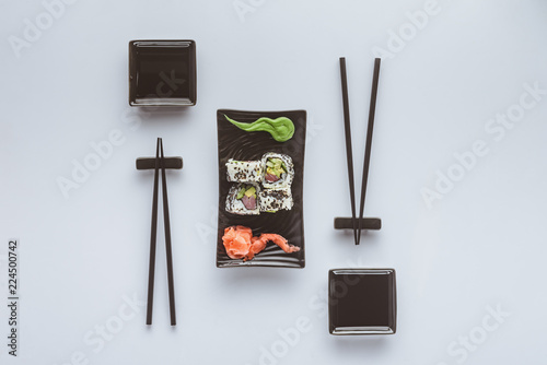 top view of gourmet sushi with chopsticks, ginger and wasabi isolated on white Wallpaper Mural