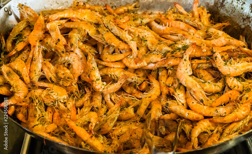 Shrimps fried on pan with herbs