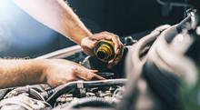 Hand Mechanic In Repairing Car...