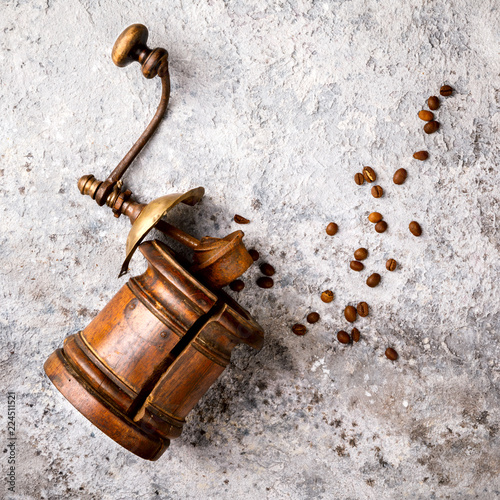 Foto op Plexiglas Retro Coffee grinder Hand Vintage with roasted coffee beans.Wooden on a gray background. Top View.Copy space for Text.